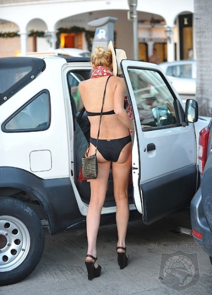 Lohan Fashion Faux Pas: Bikini, Heels And A Suzuki ...